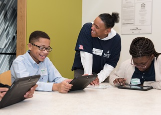 Host employees volunteer with Junior Achievement to help students learn about fiscal responsibility.