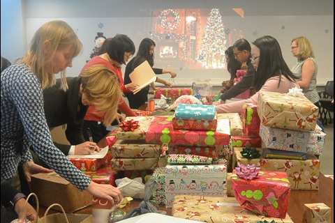 Employees wrapping gifts for United Way of Central Maryland
