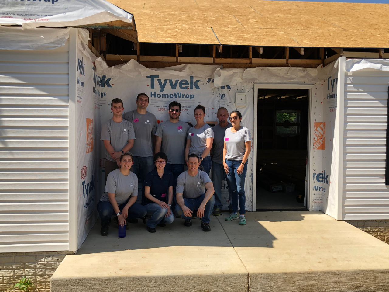 Host employees help at a house in Capitol Heights, MD