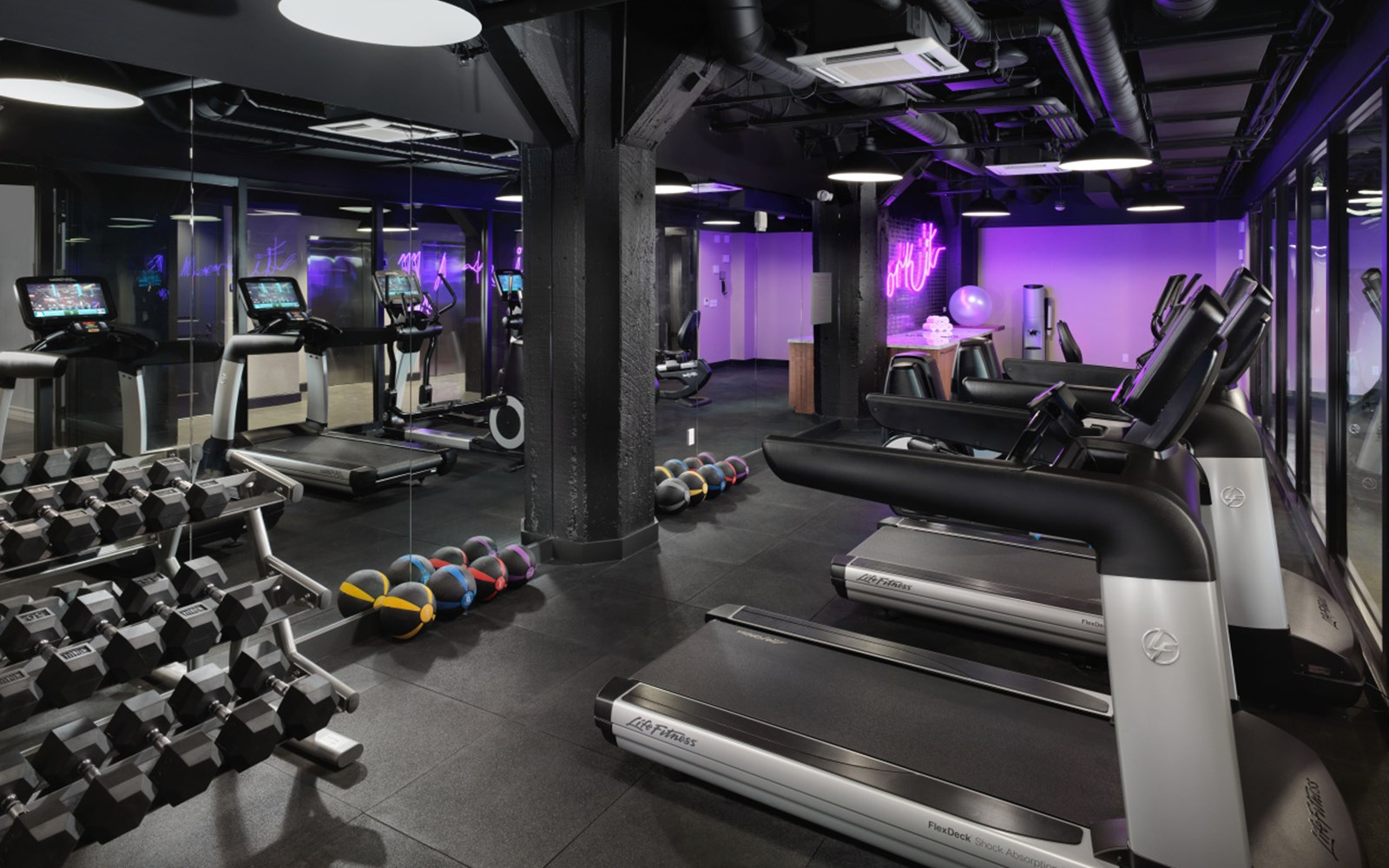 Fitness room with machines and weights