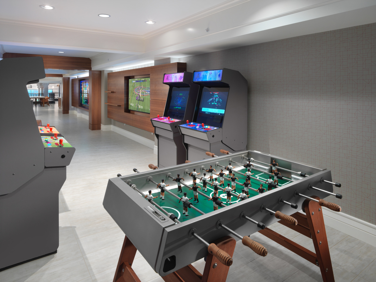 Arcade games and foosball table in the Cloud lounge