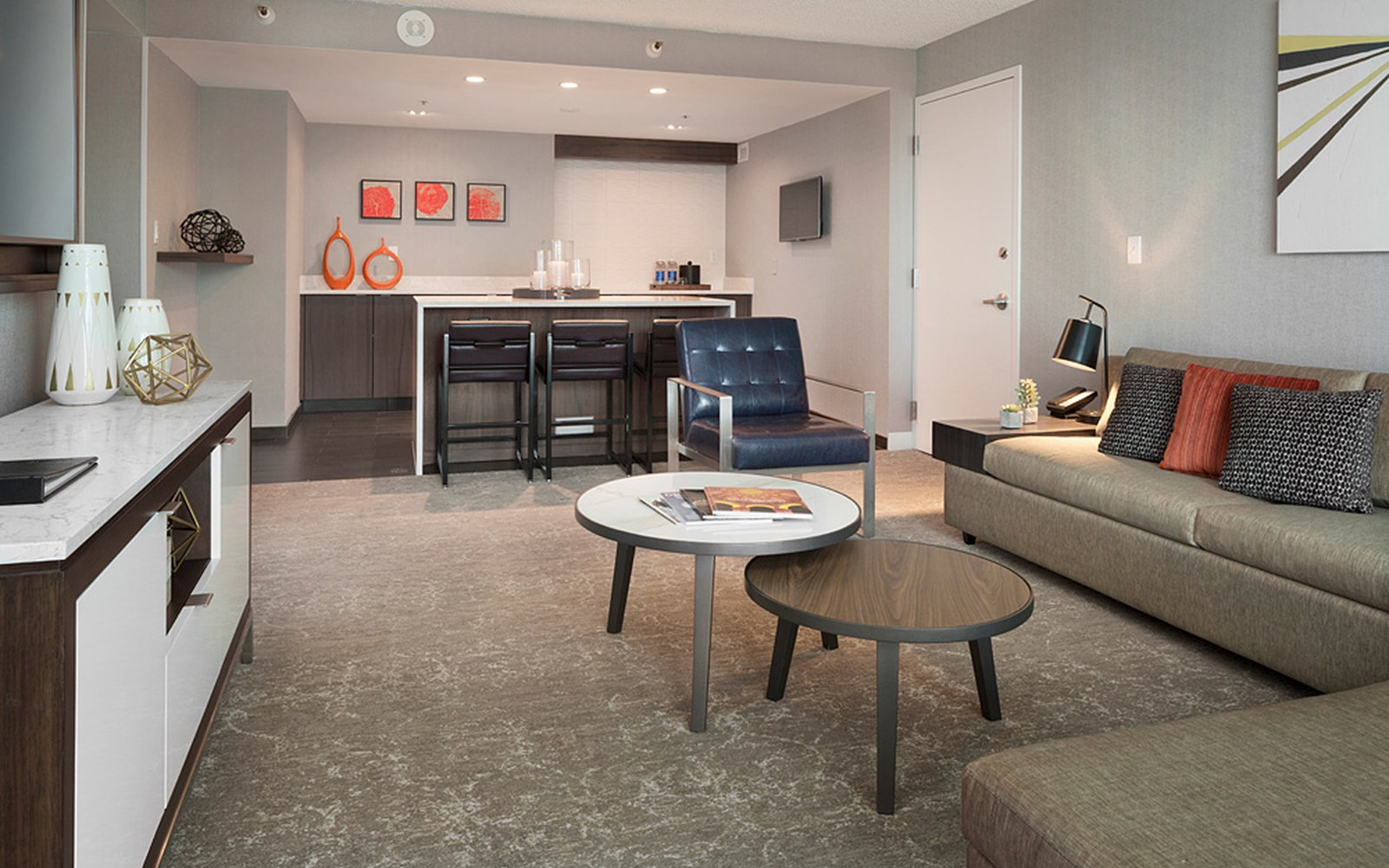 Living and dining areas of a guest room