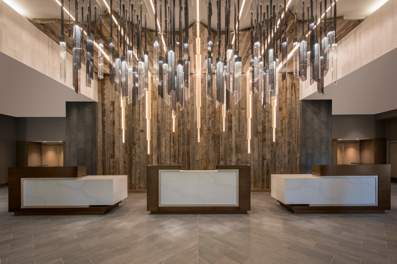 Lobby with sculptural wall and ceiling installation that represent the Rocky Mountains