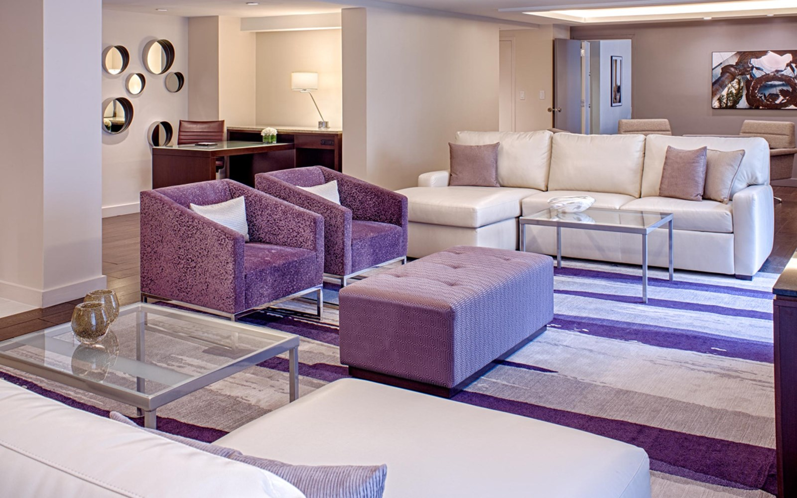Suite with purple and ivory couches, TV