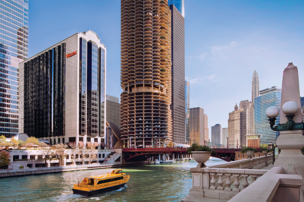 """Exterior of buildings, river, bridge, and boat""""Most Commonly Used"""" property view"""
